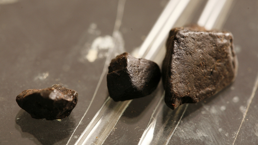 clumps of black tar heroin