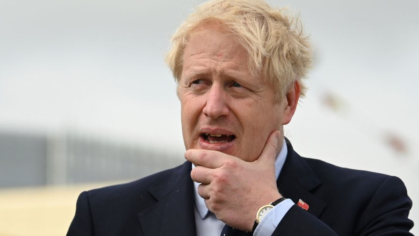 In this Sept. 12, 2019, file photo, Britain's Prime Minister Boris Johnson visits the NLV Pharos, a lighthouse tender moored on the river Thames, to mark London International Shipping Week in London.