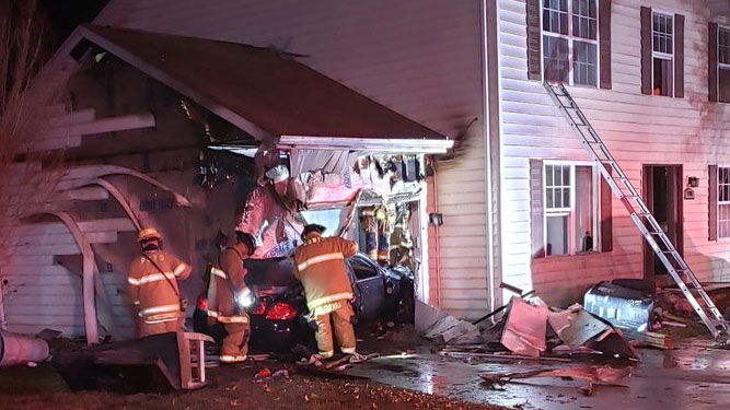 A driver crashed into a Maryland home early Tuesday morning, causing the car to burst into flames.