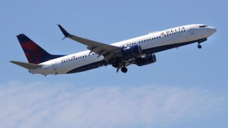 In this May 24, 2018, file photo, a Delta Air Lines passenger jet plane, a Boeing 737-900 model, approaches Logan Airport in Boston.