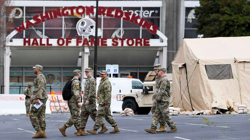 The Maryland National Guard set up tents and generators in preparation for a coronavirus testing site at the FedEx Field parking lot in Landover, Md