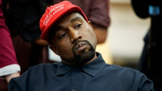 In this Oct. 11, 2018, file photo rapper Kanye West listens to a question from a reporter during a meeting in the Oval Office of the White House with President Donald Trump in Washington. On Sunday, Aug. 25, 2019, Kanye West hosted a Sunday Service in Ohio in support of those affected by the recent mass shooting. A large crowd gathered at the service in a park in Dayton.