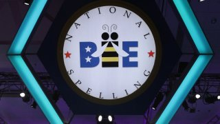 "In this May 30, 2019, file photo, Blake Bouwman of Grand Rapids, Michigan, tries to spell the word ""coelogyne"" during round eight of the Scripps National Spelling Bee at the Gaylord National Resort & Convention Center in National Harbor, Maryland."
