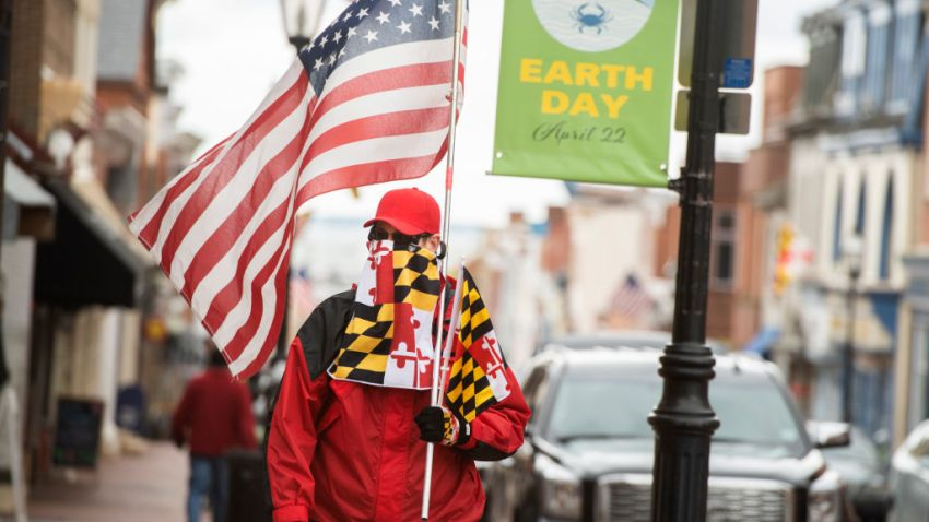 Man with Maryland flag and American flag