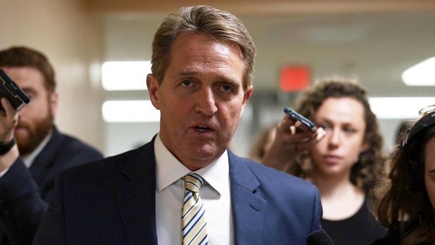 In this file photo, U.S. Sen. Jeff Flake (R-AZ) speaks to members of the media in the basement of the U.S. Capitol prior to a Senate Republican Policy Luncheon January 17, 2018 in Washington, D.C.