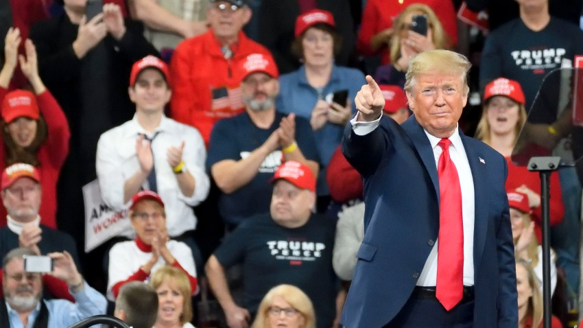 In this Dec. 10, 2019, file photo, U.S. President Donald Trump greets supporters as he steps on the stage for a campaign rally with Vice President Mike Pence at the Giant Center, in Hershey, PA.