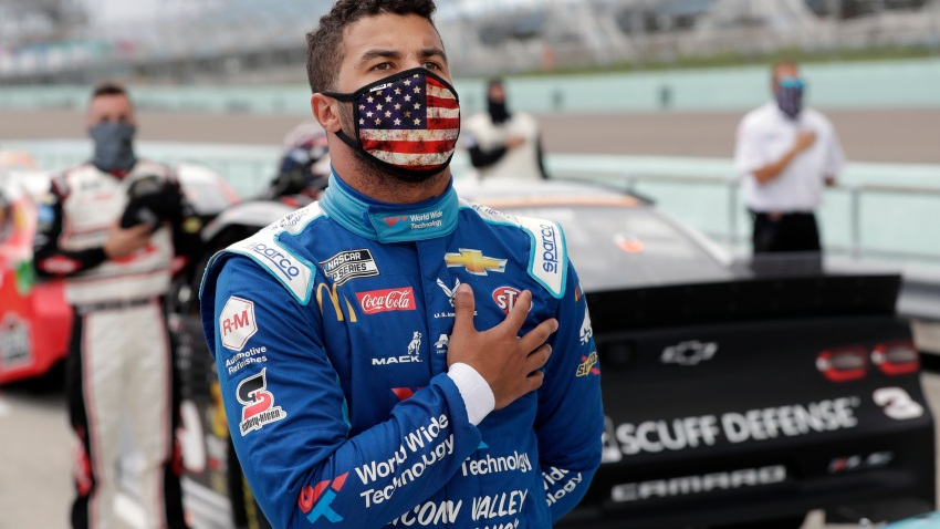 Jun 14, 2020; Homestead, Florida, USA; Driver Bubba Wallace stands for the national anthem prior to the NASCAR Cup series race at Homestead-Miami Speedway. Mandatory Credit: Wilfredo Lee/Pool Photo via USA TODAY Network