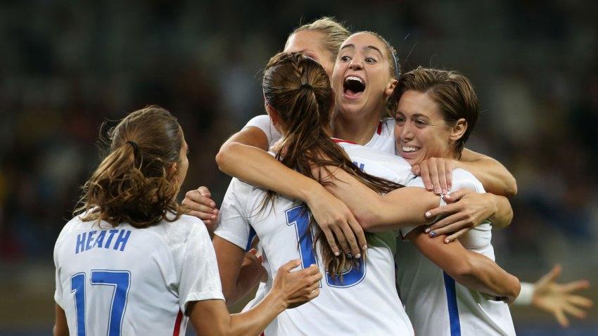 Rio Olympics Soccer Women hug each other