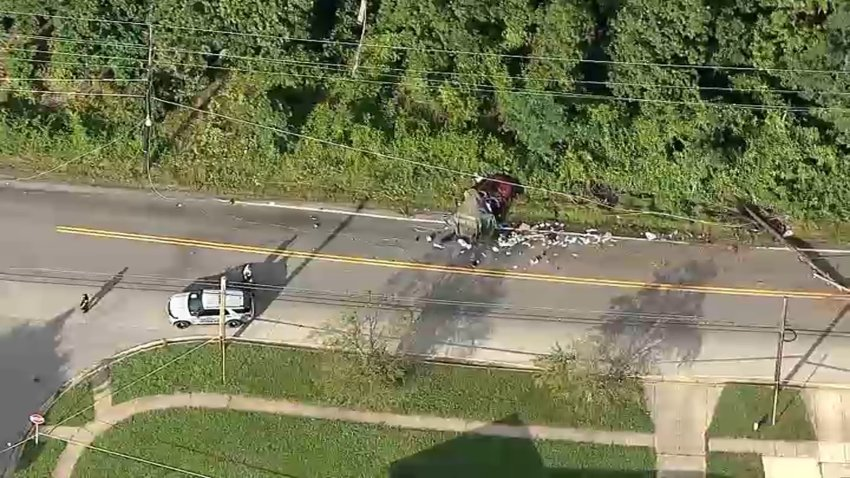 Two people were killed when their SUV crashed into utility poles.