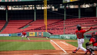 Andrew Benintendi #16 of the Boston Red Sox bats during a summer camp workout before the start of the 2020 Major League Baseball season on July 9, 2020 at Fenway Park in Boston, Massachusetts. The season was delayed due to the coronavirus pandemic.