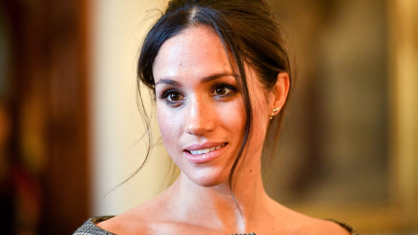 In this Jan. 18, 2018, file photo, Meghan Markle chats with people inside the Drawing Room during a visit to Cardiff Castle in Cardiff, Wales.