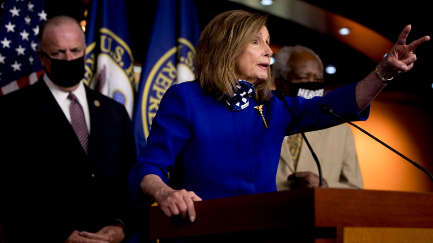 House Speaker Nancy Pelosi of Calif., accompanied by Rep. Dan Kildee, D-Mich., left, and Rep. Danny Davis, D-Ill., right, speaks at a news conference on Capitol Hill in Washington, July 24, 2020, on the extension of federal unemployment benefits.