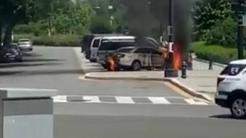 A Supreme Court police car on fire.