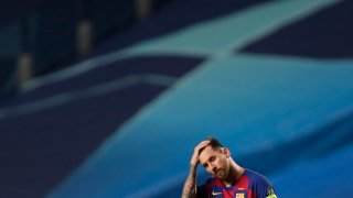Barcelona's Lionel Messi react during the Champions League quarterfinal match between FC Barcelona and Bayern Munich at the Luz stadium in Lisbon, Portugal, Friday, Aug. 14, 2020.