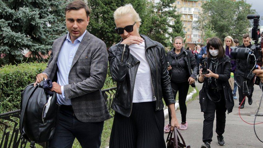 Alexei Navalny's wife Yulia, center, and Navalny's colleague Ivan Zhdanov, left, arrive to the Omsk Ambulance Hospital No. 1, intensive care unit where Alexei Navalny was hospitalized in Omsk, Russia, Friday, Aug. 21, 2020.
