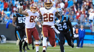 Adrian Peterson runs for a touchdown late in the fourth quarter of a game against the Carolina Panthers at Bank of America Stadium Dec. 1 in Charlotte, North Carolina.