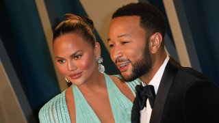 In this Feb. 9, 2020, file photo, Chrissy Teigen and John Legend attend the 2020 Vanity Fair Oscar Party at Wallis Annenberg Center for the Performing Arts in Beverly Hills, California.