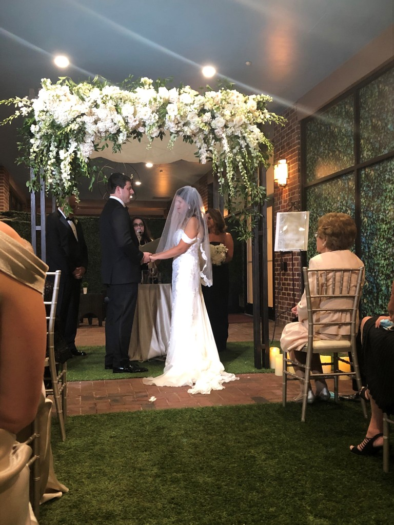 A couple gets married in the courtyard of the Four Seasons after a fire forced the evacuation of the hotel.