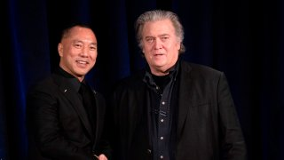 Former White House Chief Strategist Steve Bannon (R) greets fugitive Chinese billionaire Guo Wengui before introducing him at a news conference on November 20, 2018 in New York, on the death of of tycoon Wang Jian in France on July 3, 2018.