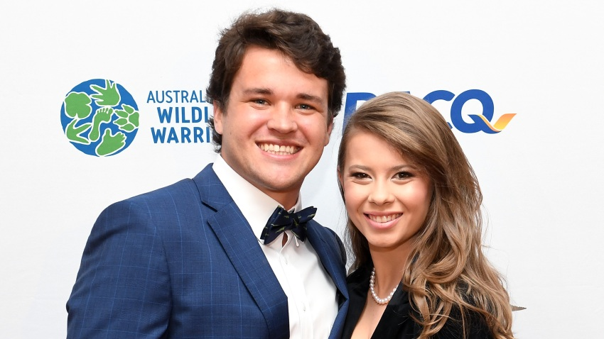 Bindi Irwin poses for a photo with fiancé Chandler Powell