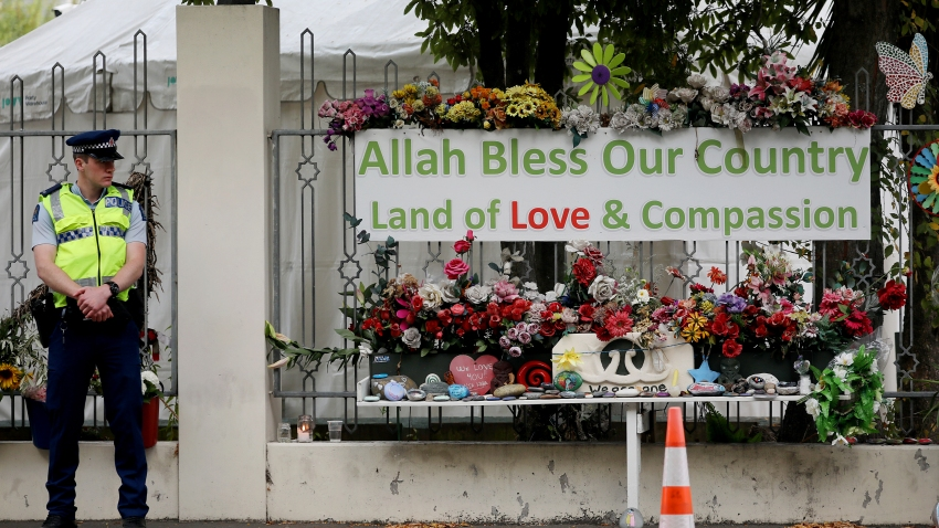 A police officer stands guard outside the Al Noor mosque in Christchurch, New Zealand on March 15, 2020.
