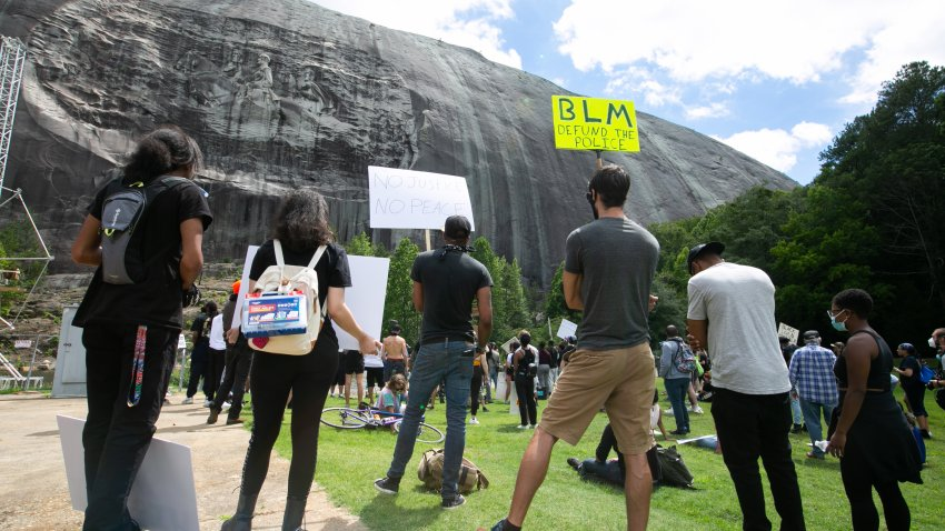 Black Lives Matter protesters gather in front of the Confederate carving in Stone Mountain Park on June 16, 2020 in Stone Mountain, Georgia. The march is to protest confederate monuments and recent police shootings.