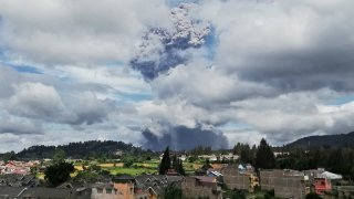 Mount Sinabung spews volcanic materials into the air as it erupts, in Karo, North Sumatra, Indonesia, Monday, Aug. 10, 2020.