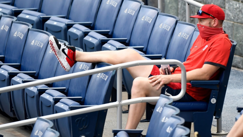 Stephen Strasburg of the Washington Nationals watching a game against the Toronto Blue Jays from the stands at Nationals Park on July 28.