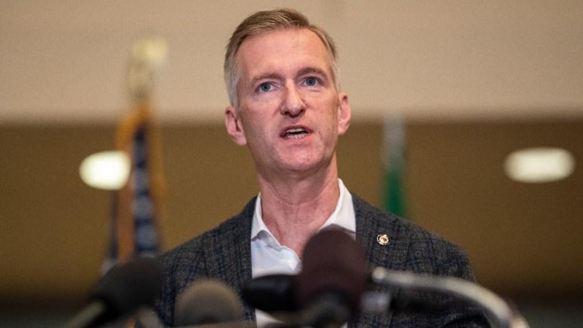 Portland Mayor Ted Wheeler speaks to the media