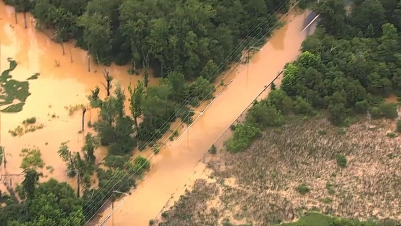 Dramatic Photos: Heavy Rain Floods Roads in Prince George's