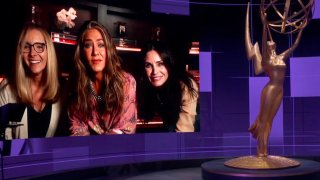In this video grab captured on Sept. 20, 2020, courtesy of the Academy of Television Arts & Sciences and ABC Entertainment, Jimmy Kimmel, right, speaks with actors, from left, Lisa Kudrow, Jennifer Aniston and Courteney Cox during the 72nd Emmy Awards broadcast.