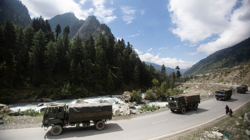 FILE - In this Tuesday, Sept. 1, 2020, file photo, an Indian army convoy moves on the Srinagar- Ladakh highway at Gagangeer, northeast of Srinagar, Indian-controlled Kashmir. As the escalating and bitter military standoff between India and China protracts following their bloodiest confrontation in decades in the Ladakh region in 2020, experts warn the two nuclear-armed countries can unintentionally slide into a war over the roof of the world. The two most populous nations share thousands of kilometers (miles) disputed border and have accused each other for opening new fronts.