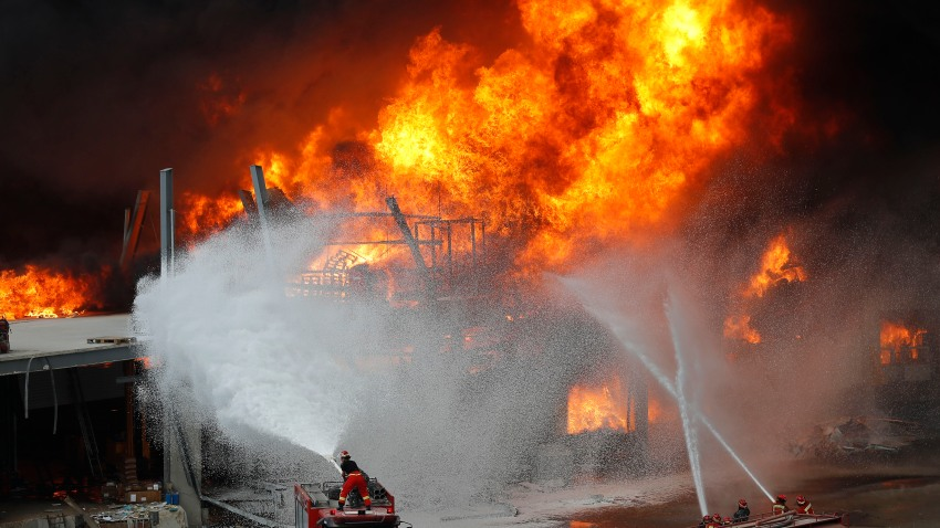 Firefighters work to extinguish a fire at warehouses at the seaport in Beirut, Lebanon, Thursday, Sept. 10. 2020. A huge fire broke out Thursday at the Port of Beirut, triggering panic among residents traumatized by last month's massive explosion that killed and injured thousands of people.