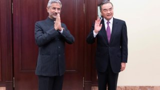 In this photo released by China's Xinhua News Agency, India's External Affairs Minister Subrahmanyam Jaishankar, left, and Chinese Foreign Minister Wang Yi pose for a photo as they meet on the sidelines of a meeting of the foreign ministers of the Shanghai Cooperation Organization (SCO) in Moscow, Russia on Sept. 10, 2020. The Indian and Chinese foreign ministers have agreed that their troops should disengage from a tense border standoff, maintain proper distance and ease tensions in the Ladakh region where the two sides in June had their deadliest clash in decades.