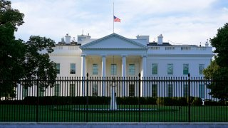 In this Saturday, Sept. 19, 2020, file photo, an American flag flies at half-staff over the White House in Washington.