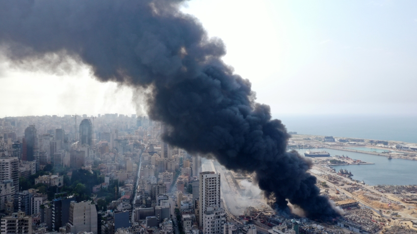 In this Sept. 10, 2020, file photo, an aerial view show the black smoke following a fire that erupted in Beirut Ports Free Zone in Beirut, Lebanon.