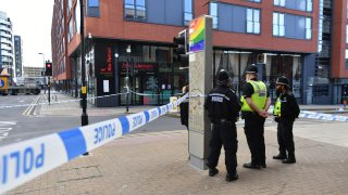 Police officers stand at a cordon in Hurst Street in Birmingham after a number of people were stabbed in the city centre, Sunday, Sept. 6, 2020. British police say that multiple people have been injured in a series of stabbings in a busy nightlife area of the central England city of Birmingham.