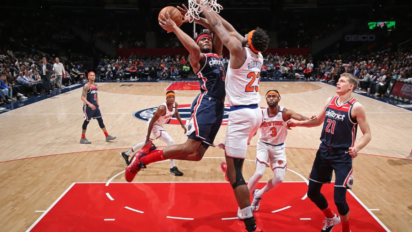 Bradley Beal shoots the ball against the New York Knicks on March 10, 2020, at Capital One Arena in Washington, D.C.