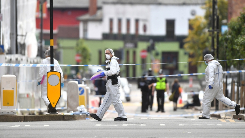 Police forensic officers investigate after stabbings in Birmingham, northern England, Sunday Sept. 6, 2020.