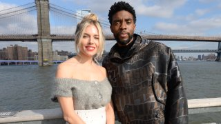 """In this Nov. 19, 2019, file photo, Sienna Miller(L) and Chadwick Boseman poses during a photo call for """"21 Bridges"""" at The Fulton in New York City."""
