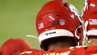 Juan Thornhill #22 of the Kansas City Chiefs wears End Racism on the back of his helmet during the fourth quarter against the Houston Texans at Arrowhead Stadium on September 10, 2020 in Kansas City, Missouri.