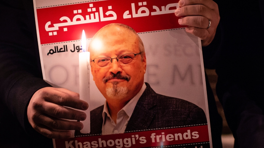 A demonstrator holds a poster picturing Saudi journalist Jamal Khashoggi