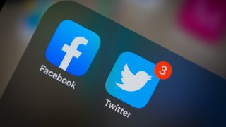 Facebook and Twitter applications are seen on an Apple iPhone 11 Pro Max in The Hague, The Netherlands on March 2, 2020.