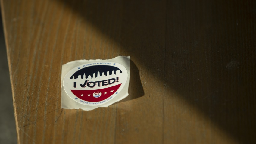 """An """"I Voted"""" sticker sits on a bench at a polling location in Brooklyn borough of New York, U.S., on Tuesday, June 23, 2020."""