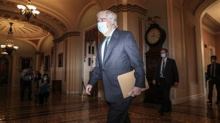 In this Sept. 30, 2020, file photo, Senate Majority Leader Mitch McConnell, a Republican from Kentucky, wears a protective mask while walking to the senate floor as Amy Coney Barrett, U.S. President Donald Trump's nominee for associate justice of the U.S. Supreme Court, not pictured meets with senators at the U.S. Capitol in Washington, D.C.
