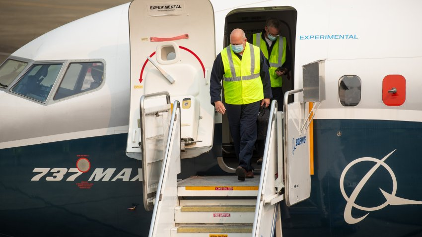 Steve Dickson, administrator of the Federal Aviation Administration (FAA), wears a protective mask while exiting a Boeing Co. 737 Max airplane after a test flight in Seattle, Washington, U.S., on Wednesday, Sept. 30, 2020. Dickson, who is licensed to fly the 737 along with several other jetliners from his time as a pilot atDelta Air Lines Inc., will be at the controls of a Max that has been updated with a variety offixesthe agency has proposed and may soon make mandatory.