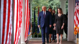 President Donald Trump, first lady Melania Trump and 7th U.S. Circuit Court Judge Amy Coney Barrett, 48, walk into the Rose Garden before Trump announces Barrett as his nominee to the Supreme Court at the White House September 26, 2020 in Washington, DC.