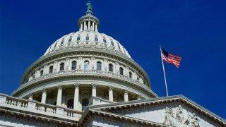 WASHINGTON, UNITED STATES - JANUARY 01: The stars and stripes flag flying at the Capitol Building, Washington, USA.