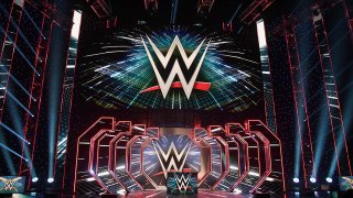 WWE logos are shown on screens before a WWE news conference at T-Mobile Arena, Oct. 11, 2019, in Las Vegas, Nev.