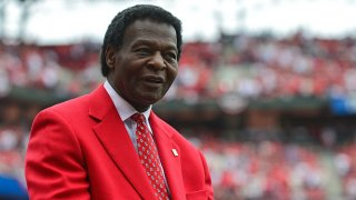 In this April 13, 2015, file photo, St. Louis Cardinals hall of famer Lou Brock looks on during the opening day ceremony before a game against the Milwaukee Brewers at Busch Stadium in St. Louis, Missouri. Brock died Sept. 6 at the age of 81.